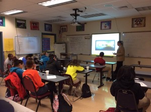 Students engaged in learning about how to be smart using social media.